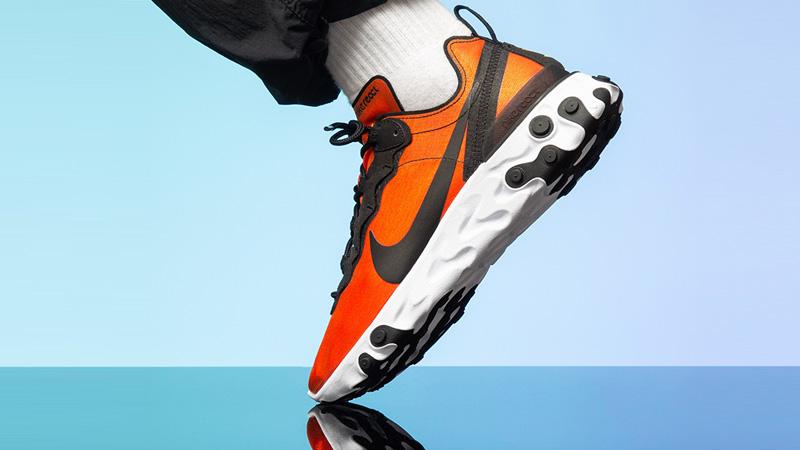 https://thesolewomens.co.uk/wp-content/uploads/2019/07/Nike-React-Element-55-Orange-Black-BQ9241-001-on-foot.jpg