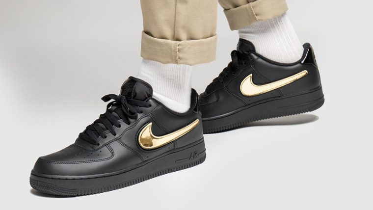 Nike Air Force 1 07 LV8 Black Gold on foot thumbnail image