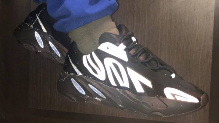 Yeezy Boost 700 MNVN Triple Black On Foot 1 thumbnail image