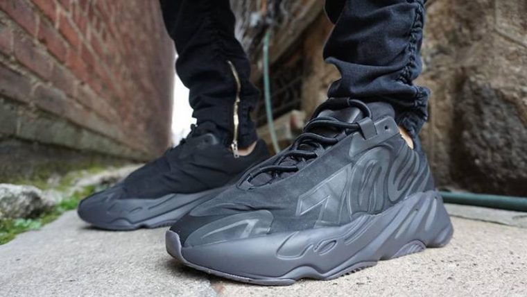 Yeezy Boost 700 MNVN Triple Black On Foot Front thumbnail image