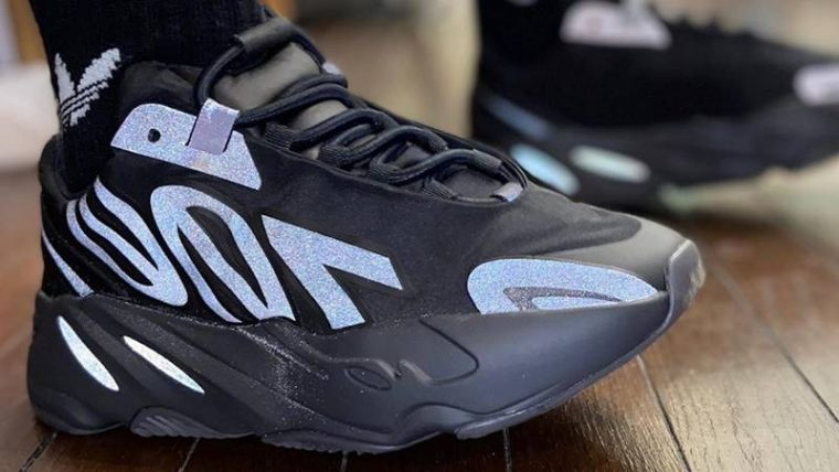 Yeezy Boost 700 MNVN Triple Black On Foot Front Side thumbnail image