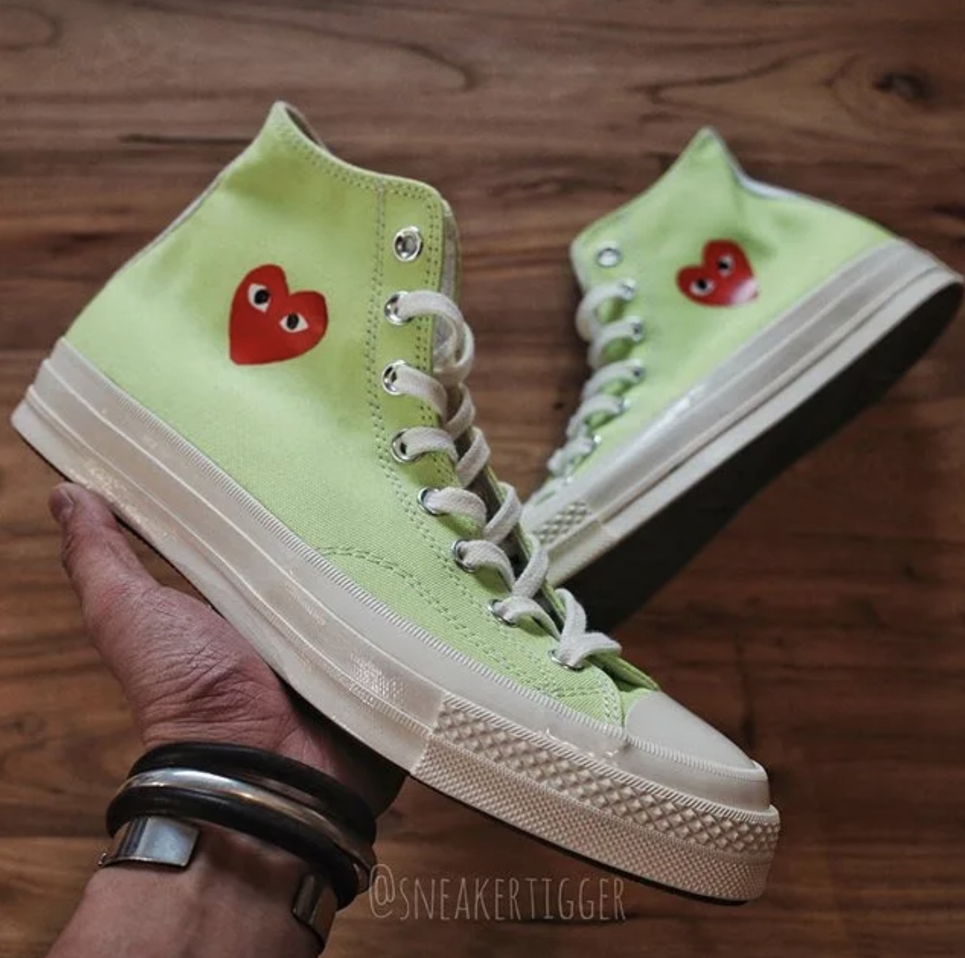 Three New Comme des Garcons Play x Converse Chuck Taylors Have Just Been Unveiled 10 green in hand