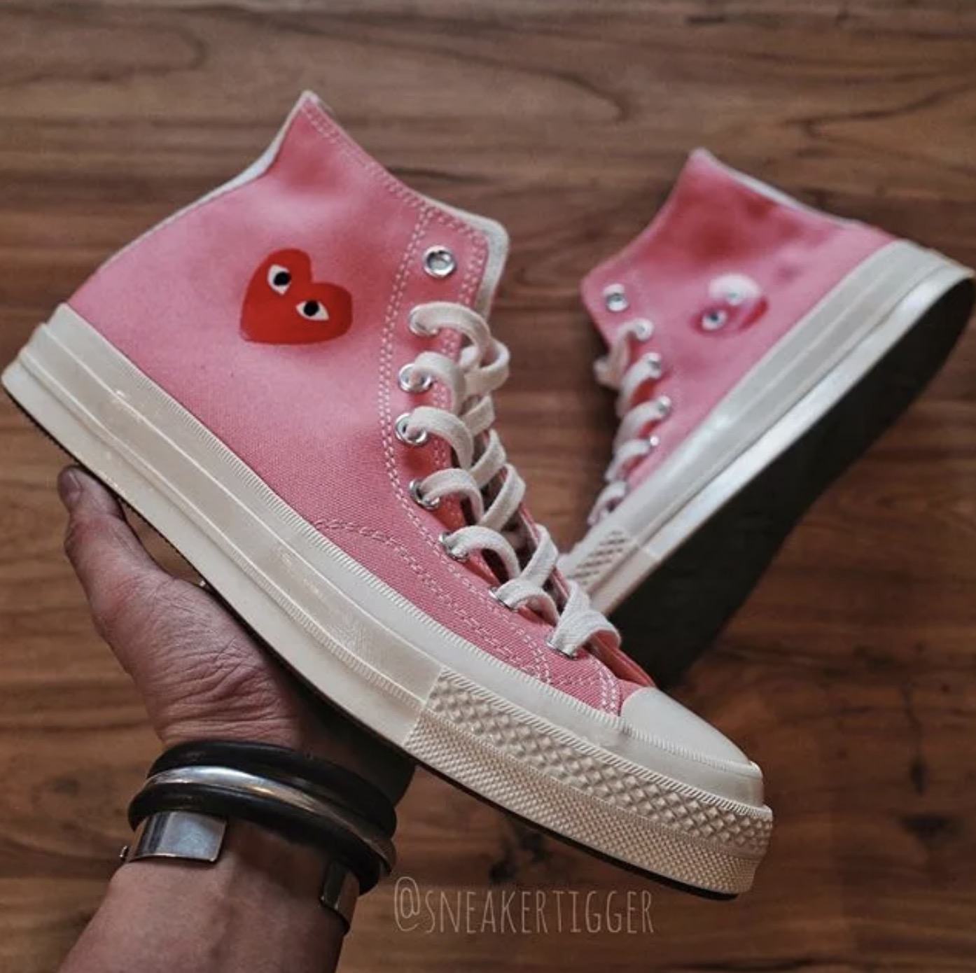 Three New Comme des Garcons Play x Converse Chuck Taylors Have Just Been Unveiled 10 pink in hand