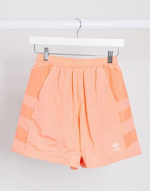adidas Originals adicolor large logo shorts in coral