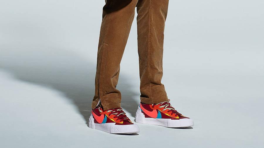 Kaws x Sacai x Nike Blazer Low Red On Foot Side